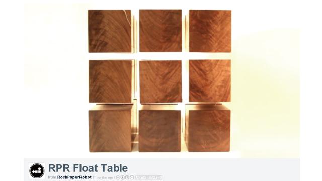磁気で反発し合う木のブロックで構成されたルービックキューブのようなテーブル