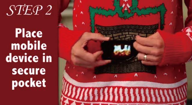 スマホを装着することでお腹がパチパチと燃える暖炉になっちゃうセーター